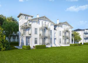 Ob Turmaufbauten, Balkone oder Giebelschmuck: Die Anleihen an die alpenländische Architektur sind unverkennbar.